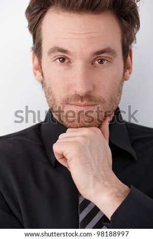 Closeup portrait of handsome young businessman looking at camera. - stock photo