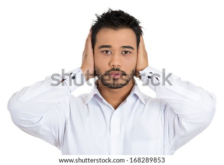 Closeup portrait of handsome young man covering his ears with hands eyes wide open closed mouth, isolated on white background.  Hear no evil concept. Human emotions facial expressions, - stock photo