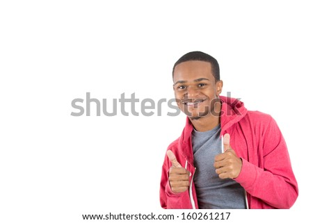 Closeup portrait of handsome young smiling man in red hoody giving two thumbs up at camera isolated on white background with copy space. Positive human emotions and signs. - stock photo