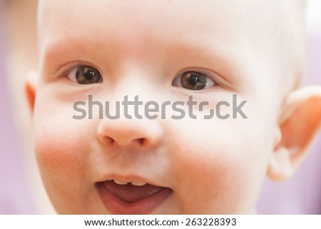 closeup portrait of happy baby - stock photo