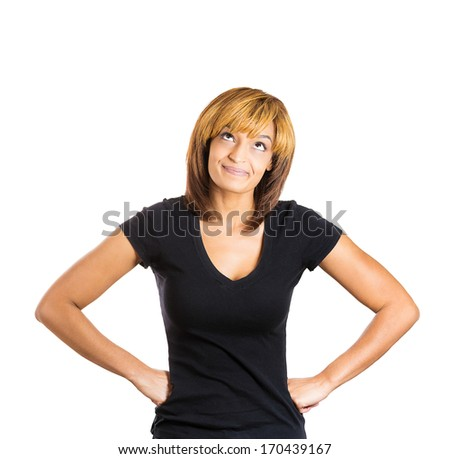 Closeup portrait of happy beautiful woman hands fists on hip and looking upwards above, isolated on white background. Positive human emotion facial expression feelings. Body language - stock photo
