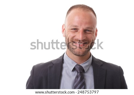 Closeup portrait of happy businessman smiling, looking at camera. - stock photo