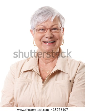 Closeup portrait of happy elderly lady, smiling, looking at camera. - stock photo