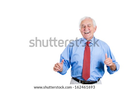 Closeup portrait of happy, jolly, elderly senior mature guy in blue shirt and red tie giving thumbs up laughing isolated on white background with copy space. Positive human emotions facial expressions - stock photo