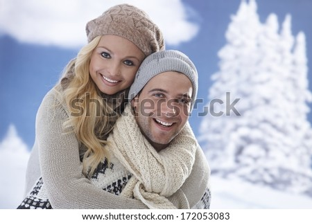 Closeup portrait of happy loving couple embracing at wintertime. - stock photo