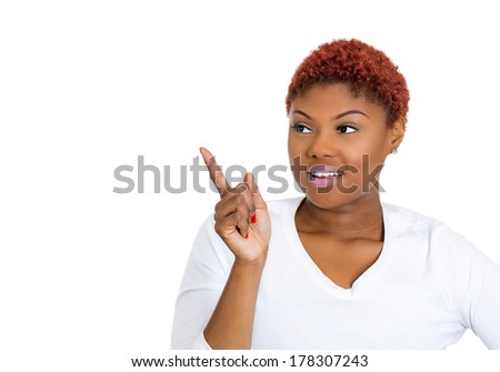 Closeup portrait of happy, pretty, confident young smiling woman gesturing, pointing to space at left isolated on white background. Positive human emotions, signs, symbol, facial expressions, feelings - stock photo