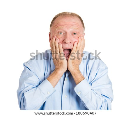 Closeup portrait of happy, senior mature man looking shocked surprised in full disbelief hands on cheek open mouth eyes, isolated on white background. Positive human emotion facial expression feeling - stock photo