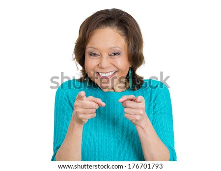Closeup portrait of happy senior mature woman in aqua sweater pointing at you with two index fingers gesture, isolated on white background. Positive human emotion facial expression feelings, symbols - stock photo