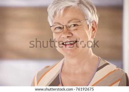 Closeup portrait of happy senior woman with glasses looking at camera, smiling.? - stock photo