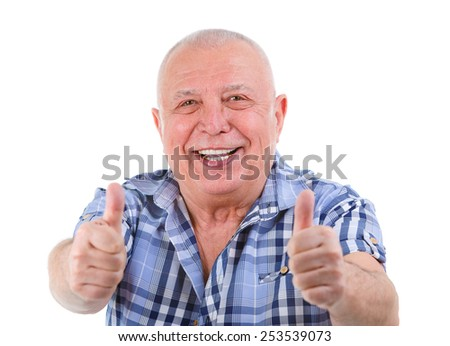 Closeup portrait of Happy smiling senior with white teeth, shows gesture two thumbs up. Focus on face, fingers blurred. Isolated on white  - stock photo
