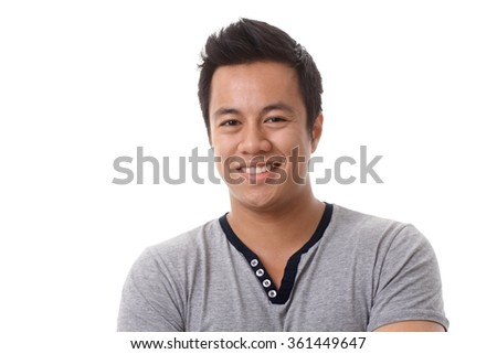Closeup portrait of happy young Asian man smiing, looking at camera. - stock photo