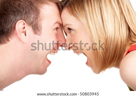 Closeup portrait of happy young couple looking face to face to each other - stock photo