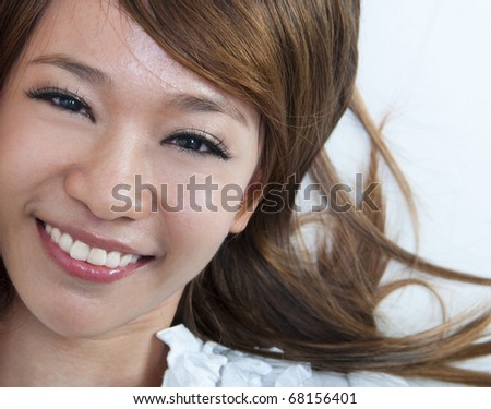 Closeup portrait of happy young girl lying on ground - stock photo