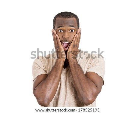 Closeup portrait of happy young handsome man looking shocked surprised in full disbelief hands on cheek open mouth eyes, isolated on white background. Positive human emotion facial expression feeling - stock photo