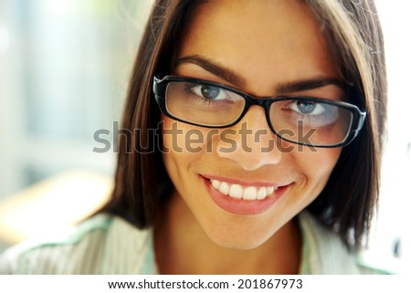 Closeup portrait of happy young woman - stock photo