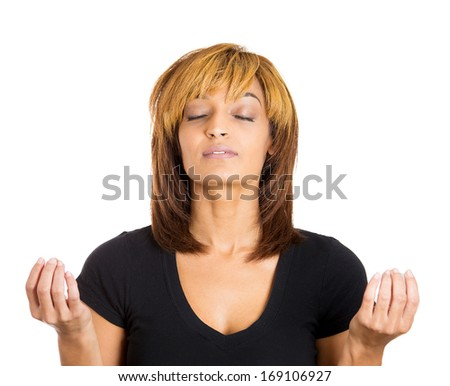 Closeup portrait of happy, young woman in meditation zen mode, isolated on white background. Stress relief techniques concept. Positive human emotions, facial expressions, signs, feelings, perception - stock photo