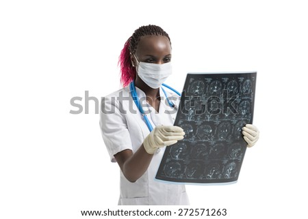 Closeup portrait of intellectual african woman healthcare doctor with white labcoat, looking at brain x-ray radiographic image, ct scan, mri, isolated white background. Radiology department - stock photo