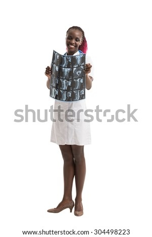 Closeup portrait of intellectual african woman healthcare doctor with white labcoat, looking at neck x-ray radiographic image, ct scan, mri, isolated white background. Radiology department - stock photo