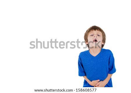 Closeup portrait of kid doubled over in pain clutching stomach with hands, isolated on white background with copy space - stock photo