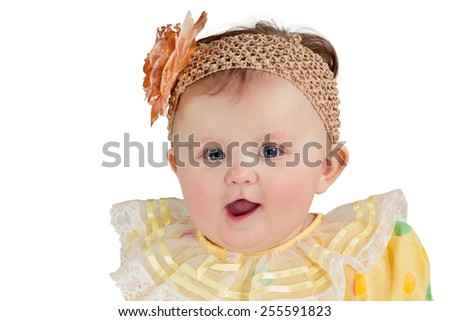 Closeup portrait of little girl with a patch with flower on his head isolated on white background - stock photo