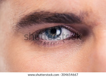 Closeup portrait of male eyes - stock photo