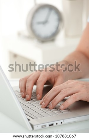 Closeup portrait of male hands typing on laptop computer keyboard. - stock photo