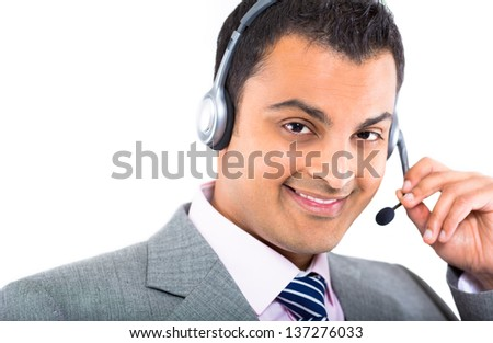 Closeup portrait of male helpdesk person assisting over phone with headset, isolated on white background - stock photo