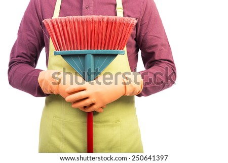 Closeup portrait of man holding a sweep over white background - stock photo