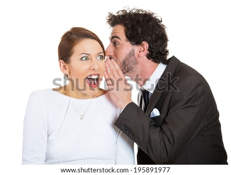 Closeup portrait of man whispering into woman's ear telling her something funny, shocking. Happy smiling cheerful response. Positive communication human emotion facial expression feeling body language - stock photo