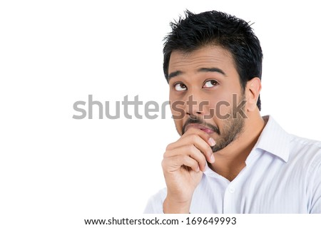 Closeup portrait of man with finger in mouth, sucking thumb, biting fingernail in stress, deep thought, isolated on white background. Negative emotion, facial expression, feelings - stock photo
