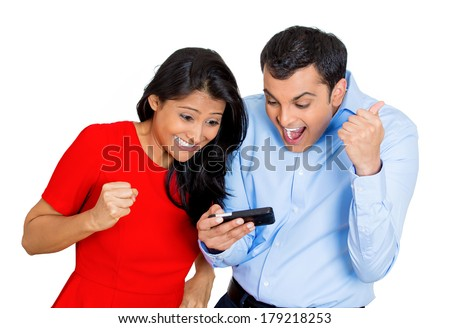 Closeup portrait of man woman looking happy, excited, amazed, on a cell phone watching a sports game match or reading an sms, e-mail, viewing latest news, isolated on a white background. - stock photo