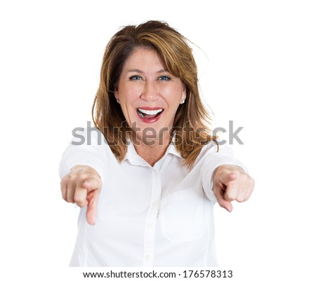Closeup portrait of middle-age laughing excited, happy woman pointing at you camera gesture with two arms, isolated on white background. Positive emotion facial expression feelings, body language - stock photo