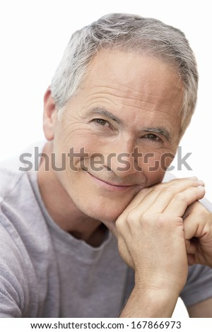 Closeup portrait of middle aged man relaxing by pool - stock photo