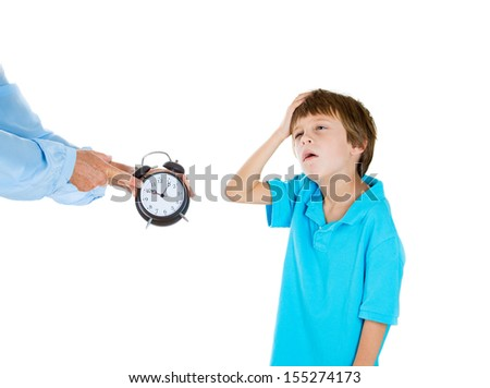 Closeup portrait of mom showing kid clock that it is time to go to bed.  He doesn't like that.  Isolated on white background - stock photo