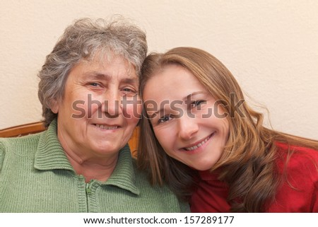 Closeup portrait of mother and her daughter - stock photo