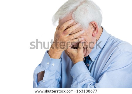 Closeup portrait of old, depressed, sad man, senior executive, grandfather, corporate worker with headache, covering his face with hands, isolated on white background. Human emotions and expressions - stock photo