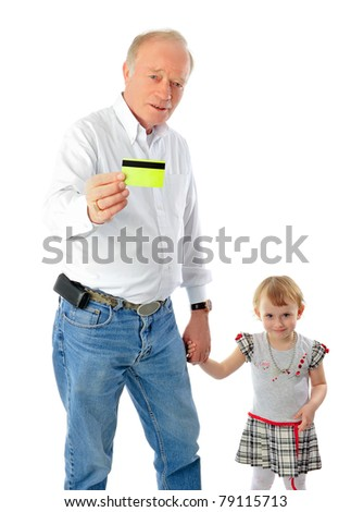 Closeup portrait of old man and his daughter. They are walking together hand in hand. He is holding credit card and wants to buy a gift to his child - stock photo
