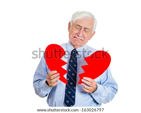 Closeup portrait of old man, senior executive, businessman, corporate employee, mature guy, holding broken heart in his hands, about to cry, isolated on white background. Human emotions, expressions - stock photo