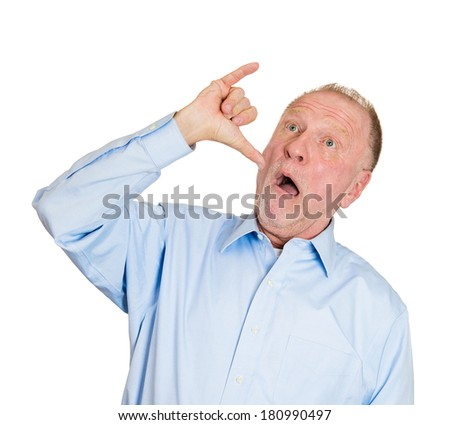 Closeup portrait of old silly goofy man gesturing with hand thumb to go out party, get drunk, hammered, wasted, tipsy, isolated on white background. Positive emotions, facial expression feeling, signs - stock photo