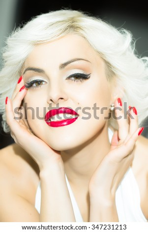 Closeup portrait of one attractive sensual smiling young retro woman with blonde hair red lips in white dress in monroe style indoor on light background, vertical picture - stock photo