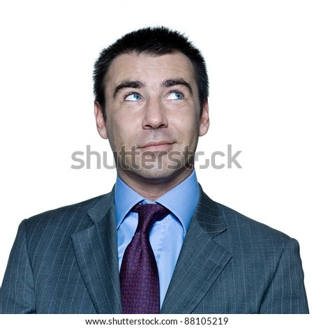 Closeup portrait of pensive handsome smiling man looking up in studio on isolated white background - stock photo