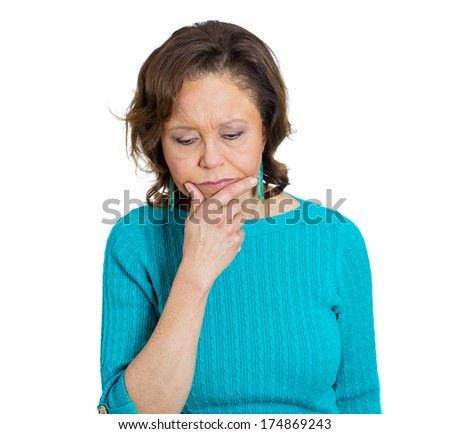 Closeup portrait of pensive senior mature woman daydreaming serious thoughts, chin on hand, wondering about stressful issues, isolated on white background. Negative emotion facial expression feelings - stock photo
