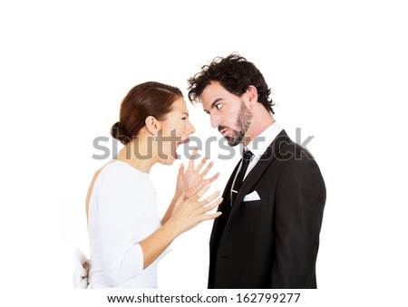 Closeup portrait of people, man and woman, wife screaming at angry husband, blaming each other for problem, isolated on white background. Marriage difficulties concept, negative emotions, expressions. - stock photo