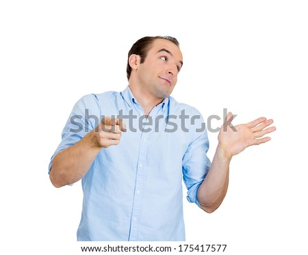 Closeup portrait of pretending dumb clueless business man, arm out asking what's the problem I don't know, pointing at someone, blaming for his own mistakes isolated on white background. Human emotion - stock photo