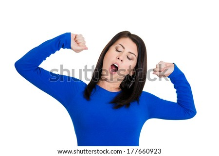 Closeup portrait of pretty beautiful tired fatigued woman stretching extending arms, back, shoulders , yawning, isolated on white background. Positive emotion facial expression feeling - stock photo