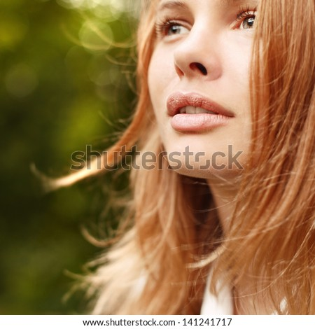 Closeup portrait of pretty cute beautiful woman in park - stock photo