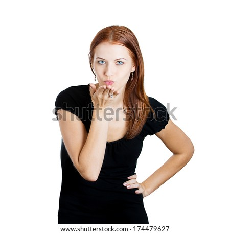 Closeup portrait of pretty young woman puckering up lips to blow kiss at you camera gesture, isolated on white background. Positive emotion facial expression feeling, sign symbol body language - stock photo