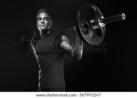 Closeup portrait of professional bodybuilder workout with barbell on black background. Black and white photo. Muscular man training squats with barbells over head - stock photo