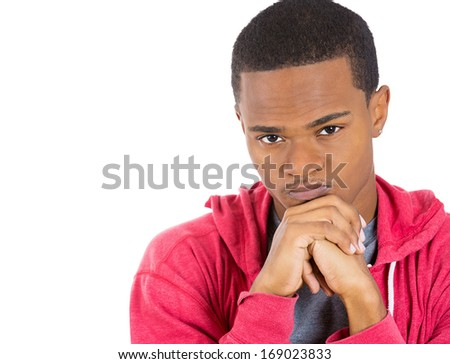 Closeup portrait of really stressed out, sad young guy, deep in thought, low in energy, resting chin on hands, isolated on white background space to left. Human emotions, feelings, attitude, reaction - stock photo