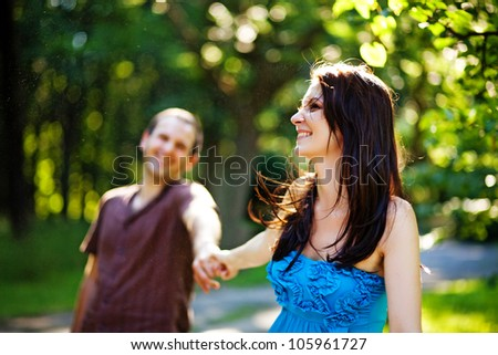 Closeup portrait of romantic young love couple in a park - stock photo